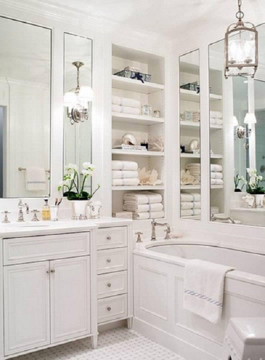 smart bathroom with recessed shelves beside rectangular mirrors ...