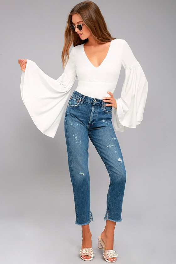 d744c0c42d9d20 Get ready for romance in the Lulus Lover's Light White Bell Sleeve Crop  Top! Silky