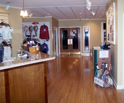 Our Tennis Pro Shop Has Everything To Meet Your Needs We Have Professional Tennis Staff On Hand For Lessons Or To Answer An Pro Shop Liquor Cabinet Home Decor