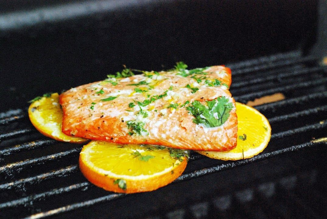 Grilled Salmon with Citrus Butter (Grilled on orange slices so there's no sticking! Love that.)