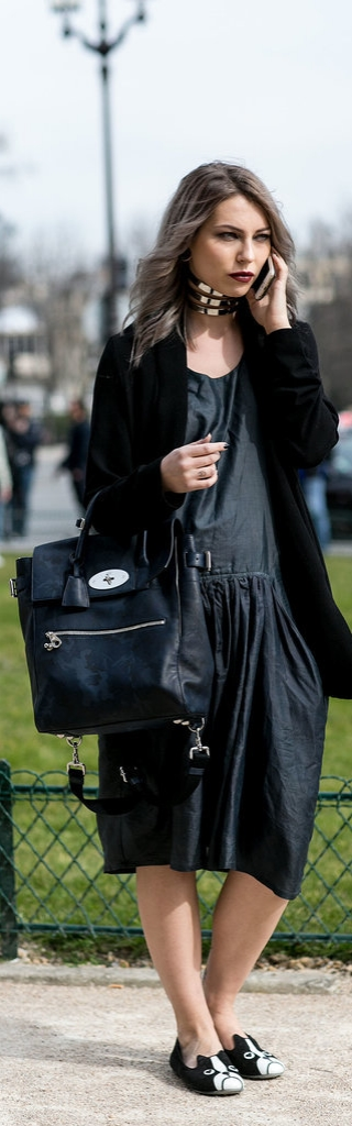 Paris Fashion Week Street Style: make all black feel fresh by playing with textures and sizes. Add a chocker, funny flats and a cool bag to finish off the look