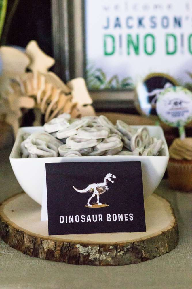 Check out this cool dinosaur bone white chocolate covered pretzels at this Dinosaurs Birthday Party! Love the dessert table! See more  party ideas and share yours at CatchMyparty.com #catchmyparty  #partyideas #dinosaurpartyfood #dinosaurparty #boybirthdayparty #boybirthdayparties