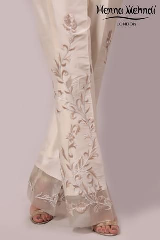 Ivory raw silk trousers with embroidery. Please note these are trousers only. Please note delivery time is approximately 4-6 weeks. There is no exchange or refu