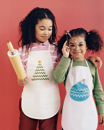 No-Sew Holiday Apron  With a festive, no-sew apron, kids can cook without the mess on their clothing this winter.  Have young crafters attach designs made of washable felt and rickrack to kid-size canvas aprons with fabric glue. An ornament doubles as a pocket (glue bottom and sides), the perfect place to stash a cookie for on-the-job nibbling.
