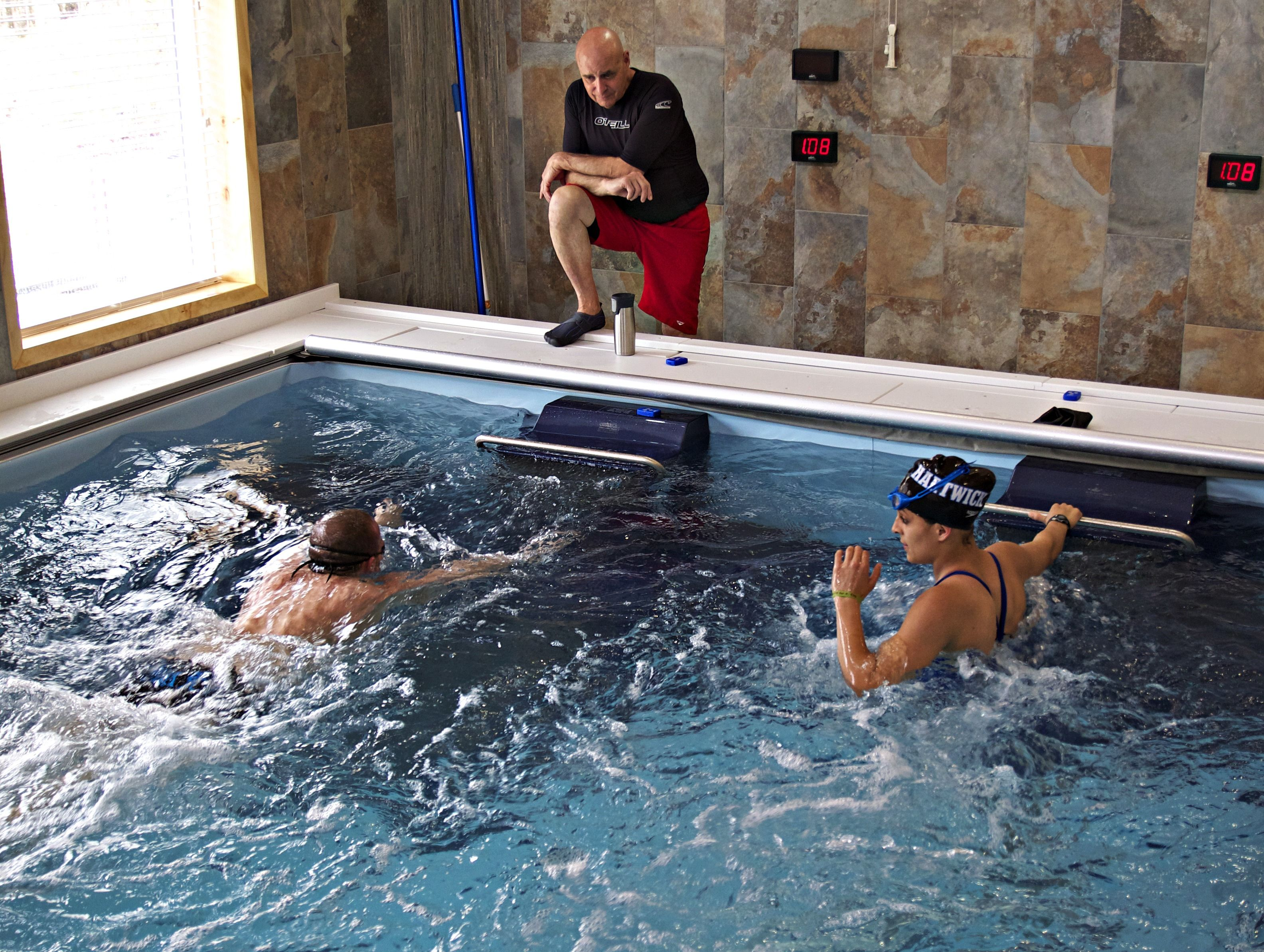 This Dual Propulsion Endless Pool Allows Room For A Pair Of Swimmers To Train At Once As A Coach Looks On Endless Pool Pool Workout Aquatic Exercises