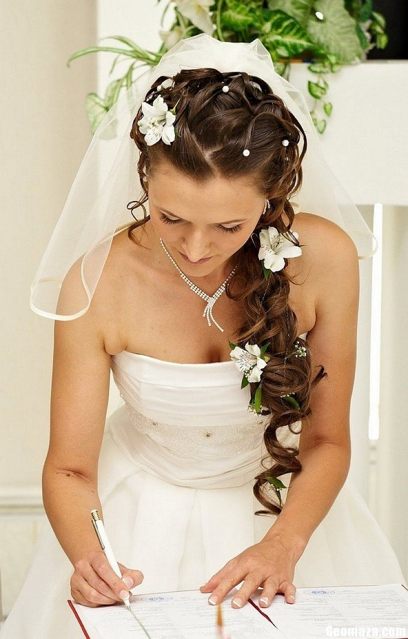 hair bun with long veil and tiara curly wedding hairstyles