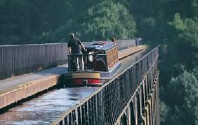 Pontcysyllte Aqueduct in Llangollen is amazing.  18 piers, 126ft high just wide enough for a narrowboat or to walk across.  Looks scary!  But I want to travel across it.