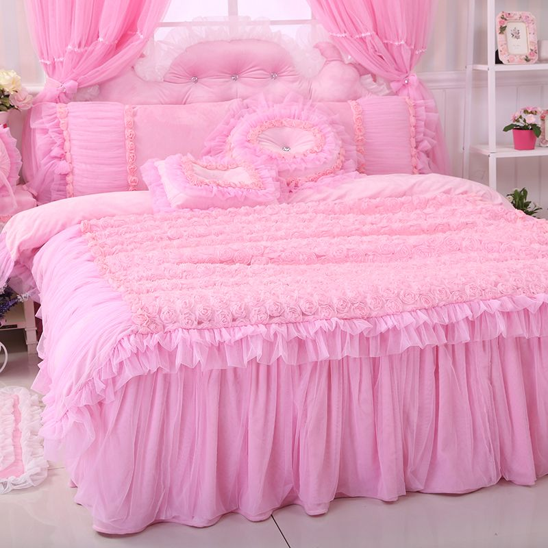 pink bedspread and pillows