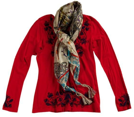 Angelica red embroidered blouse, $136, and Potter scarf, $90, Donna's Fashions.