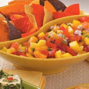Peach Mango Salsa Fresh Peach Mango Salsa. Not only is a delicious dip for your favorite tortilla chips, it goes really well with grilled chicken, pork, and fish. DELISH!!Fresh Peach Mango Salsa. Not only is a delicious dip for your favorite tortilla chips, it goes really well with grilled chicken, pork, and fish. DELISH!!