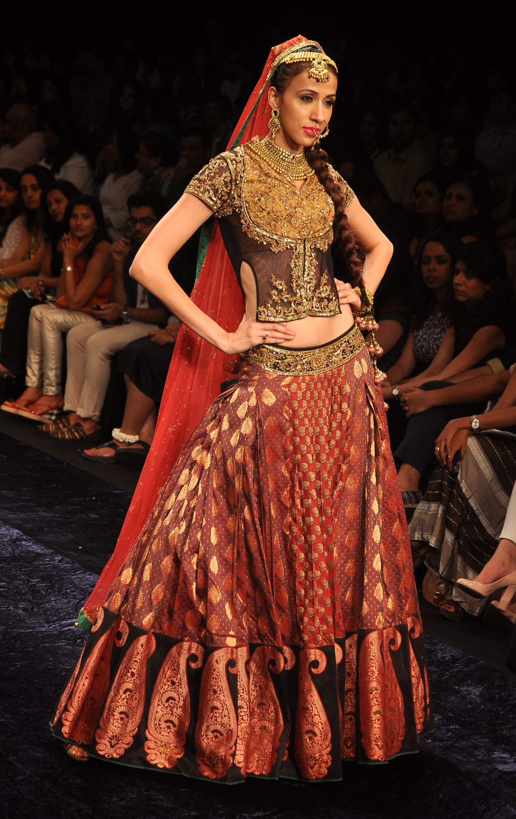 9df5d49347ba Maroon brocade lehenga with a gold blouse and a black short jacket and red  dupatta.
