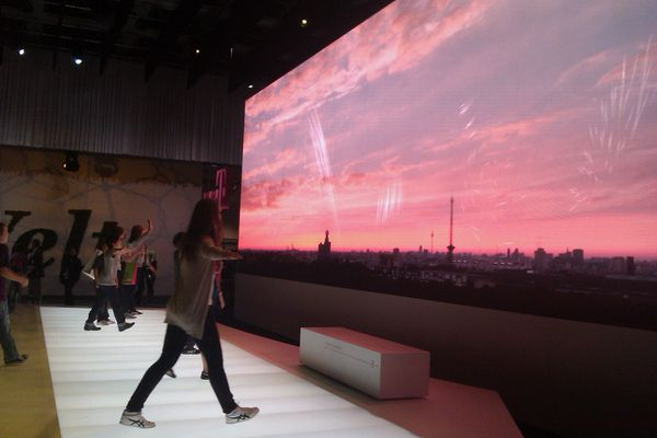 Space Category II: Open Collaboration A multi-user installation for the Deutsche Telekom booth at IFA 2010. Sunrise is a particle based scenario which attaches a particle system to each user in the tracking bar. By lifting and lowering their arms, the users were able to scale the particle system which followed them as they moved.