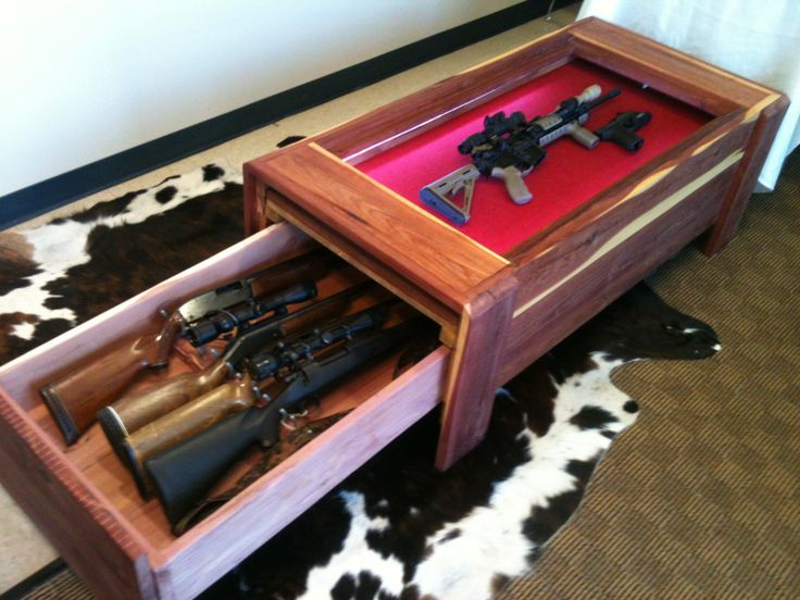 Coffee Table Gun Locker | This table displays an M1 while ...