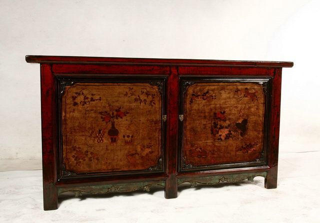 Antique sideboard with paintings