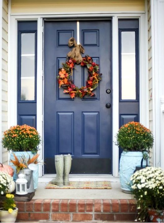 Dazzling Blue Front Door And Sidelights Framed In White House