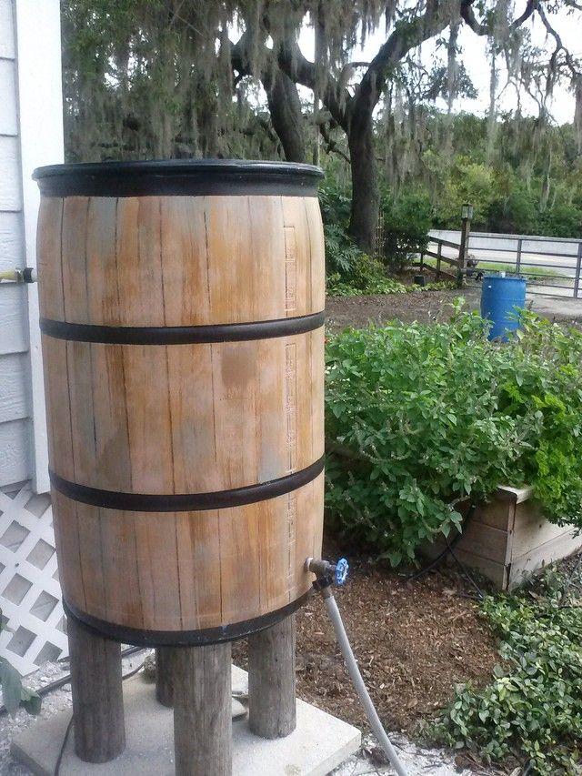 Barrel Painted To Look Like Wood Really Like The Feet Legs Rain Water Collection Rain Barrel Rain Water Collection System
