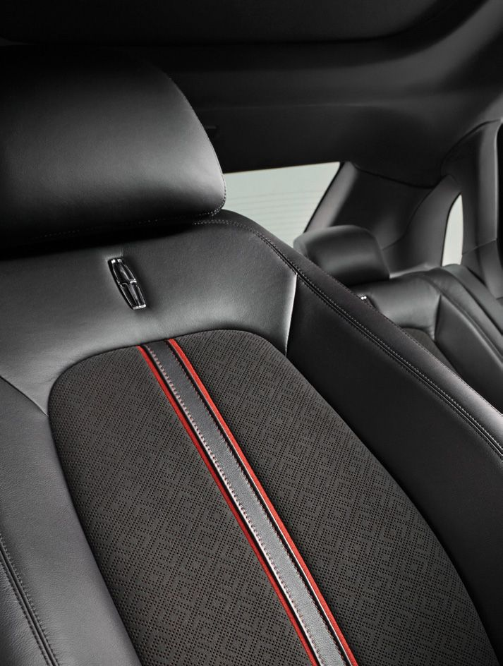 Drama is all in the details. Center Stage interiors feature plush Jet Black leather with Alcantera that's as smooth as suede, and perforated to reveal flashes of crimson below.