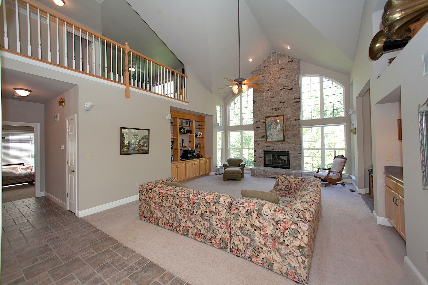 2 Story Great Room With Floor To Ceiling Windows Vaulted Ceiling