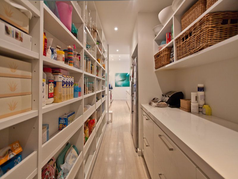 Great idea for a narrow pantry. there are narrow shelves on one side and a