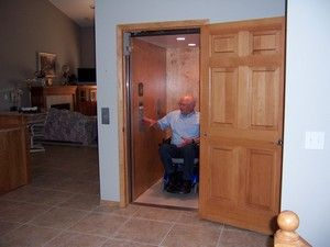 Home elevator for wheelchair users that looks like a for Small elevator for home price