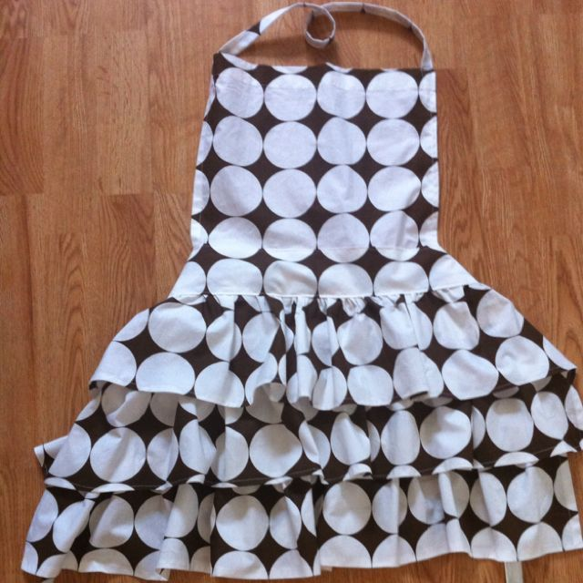 Combined a few apron tutorials to create this. Fabric is a recycled sheet.