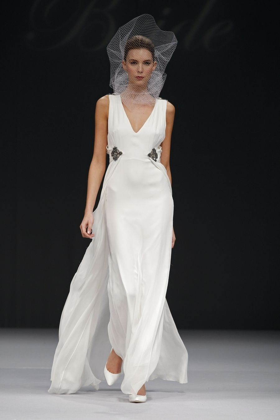 Badgley mischka wedding dress  Vneck gown in pearl silk chifon with bollowing overlay at skirt and