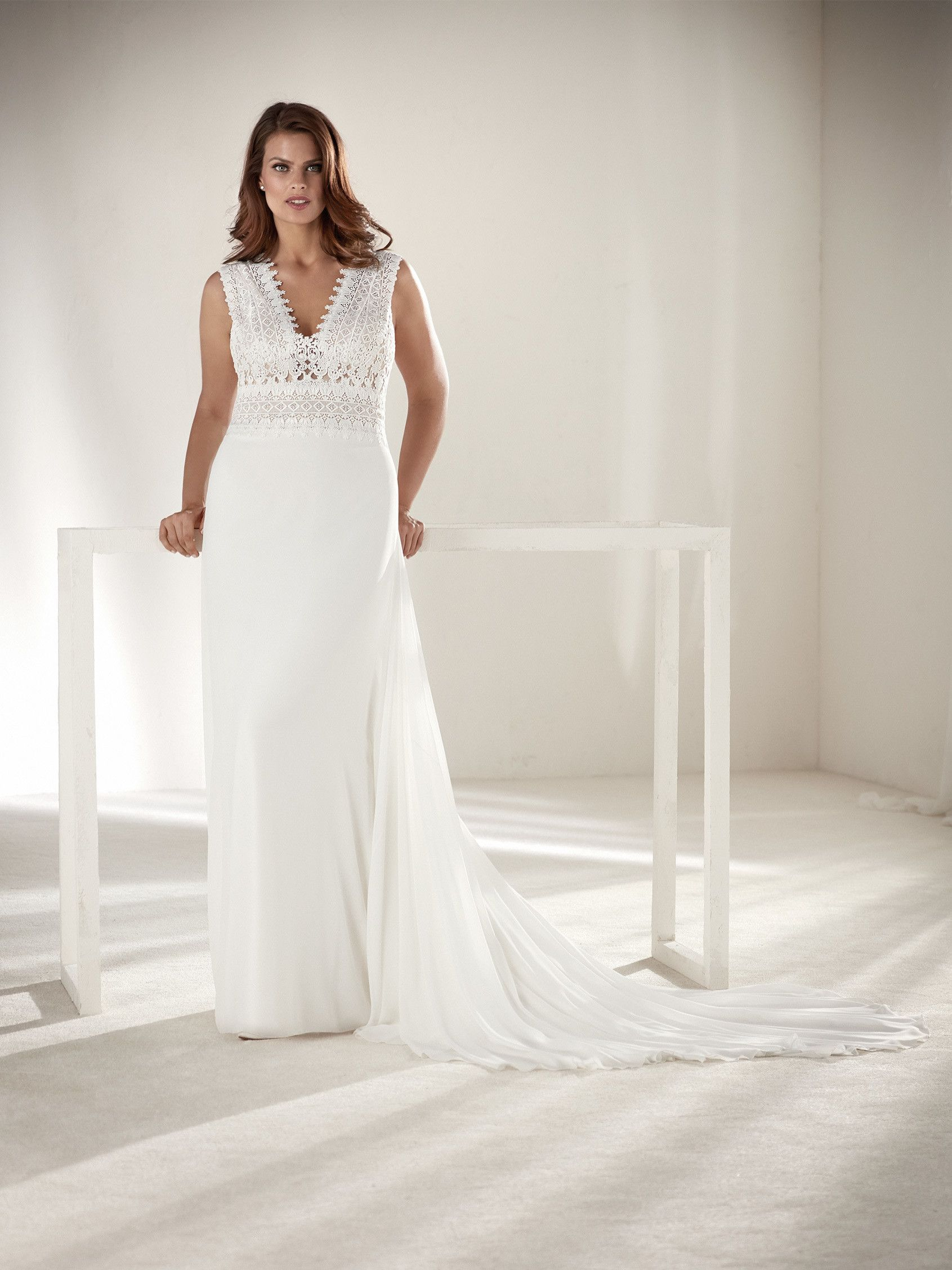 Pin by weddings romantique on 2018 stylish wedding dresses plus size bohemian wedding dress from pronovias perfect for a garden afternoon wedding ombrellifo Image collections