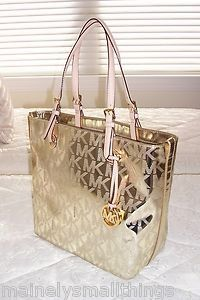 84d719f6630c NWT Michael Kors Grab Bag Convert Tote Bag MK Sig MIRROR METALLIC PALE GOLD
