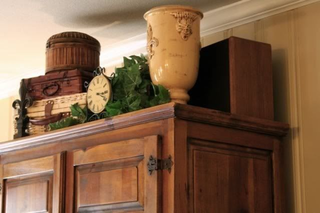 decorating ideas for tops of entertainment centers | ... decorating the empty space above an armoire or entertainment center