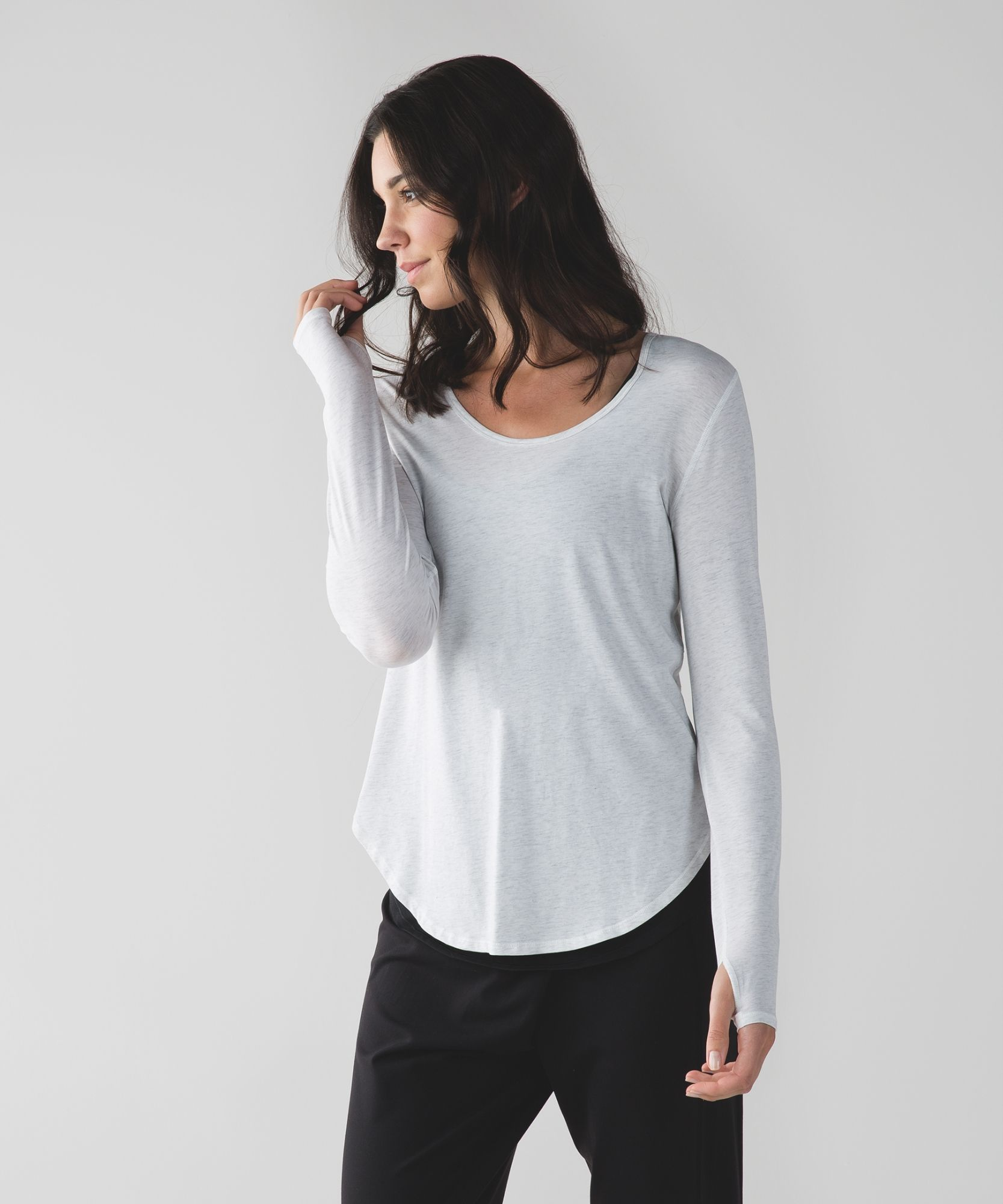 Layer this loosefitting long sleeve over your practice
