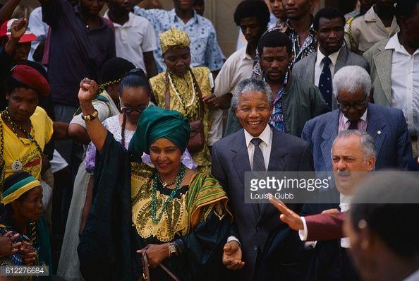 Nelson and Winnie Mandela with their lawyer, George Bizos