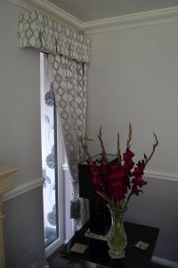 A beautiful box pleat pelmet to finish off the curtains and frame the customers window