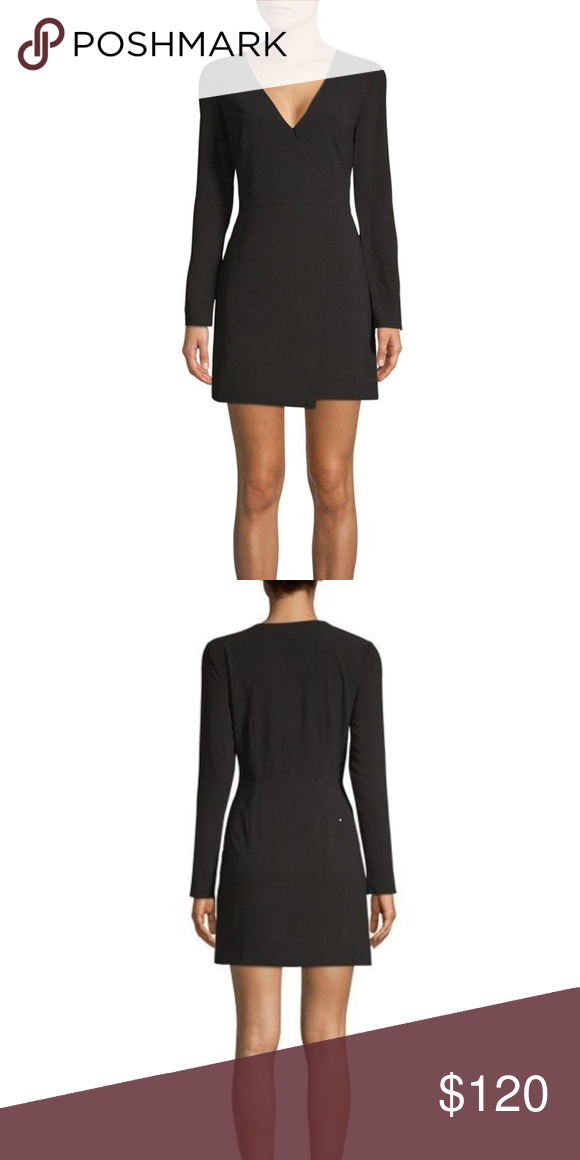 86699a90ec02 Halston Heritage Long Sleeve Wrap Mini Dress. NWT. Black Halston Heritage  Long Sleeve Wrap Mini Dress. Brand new with tags. Faux wrap detail. Deep  V-neck.