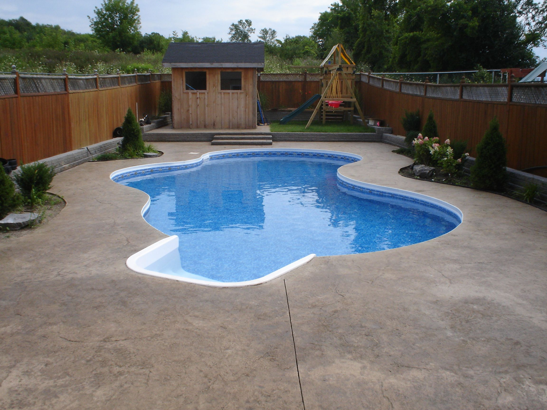 Inground Pool Kits As Fresh Space: Unique Wooden Fencing Unit Design Plan  Pool Shaped Applied Backyard Area Of Modern Home Living