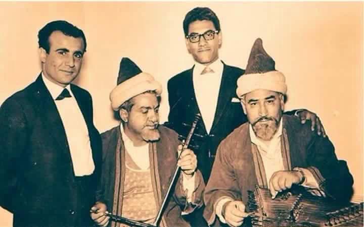 ﻋﺎﺯﻑ ﺍﻟﺴﻨﻄﻮﺭ ﺍﻟﺤﺎﺝ ﻫﺎﺷﻢ ﺍﻟﺮﺟﺐ ﻭ ﻋﺎﺯﻑ ﺍﻟﺠﻮﺯﺓ ﺍﻷﺳﺘﺎﺫ ﺷﻌﻮﺑﻲ ﺇﺑﺮﺍﻫﻴﻢ ﻓﻲ ﻣﺴﻠﺴﻞ ﺷﻬﺮﺯﺍﺩ ﺑﺘﺎﺭﻳﺦ 4 4 1965 ﻗﻴﻞ ﻟﺮﺋﻴﺲ ﺍﻟﻮ Historical Figures Character Baghdad