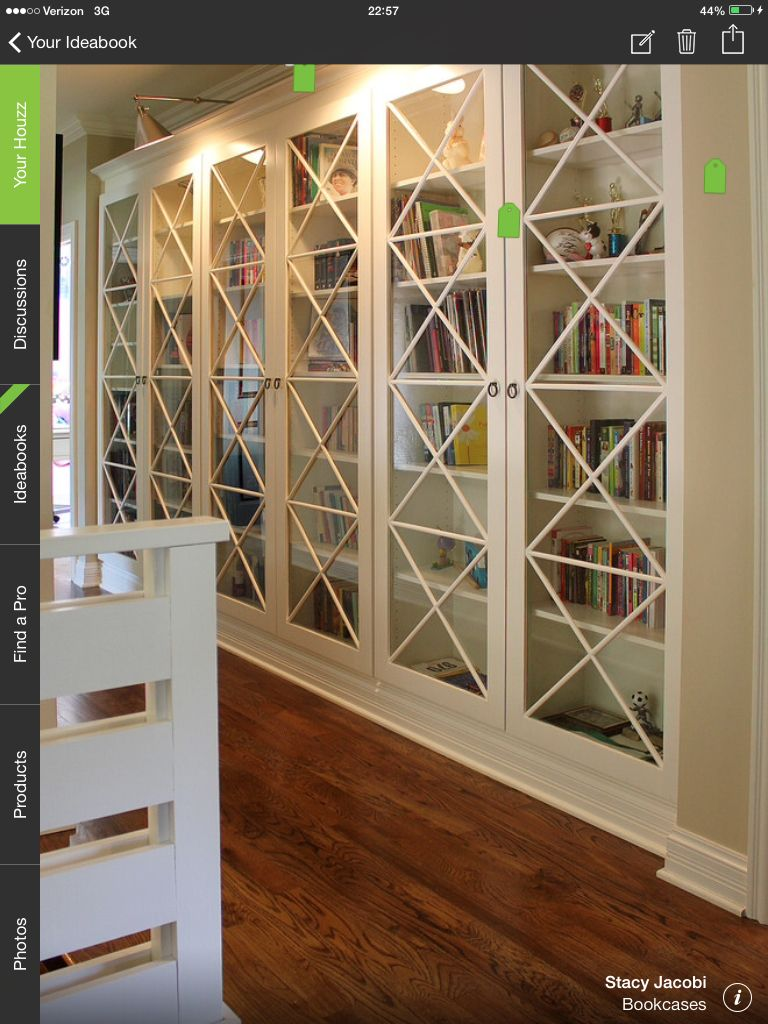Custom built in bookcases with arched tops, fluted column
