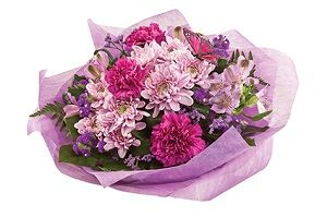 Mother's Day Flowers: 'Mum's for Mums' - Chrysanthemums are the perfect gift for Mum on Mothers Day with the addition of a butterfly and other seasonal flowers/foliages for a beautiful hand tied bouquet. Available in other colours.