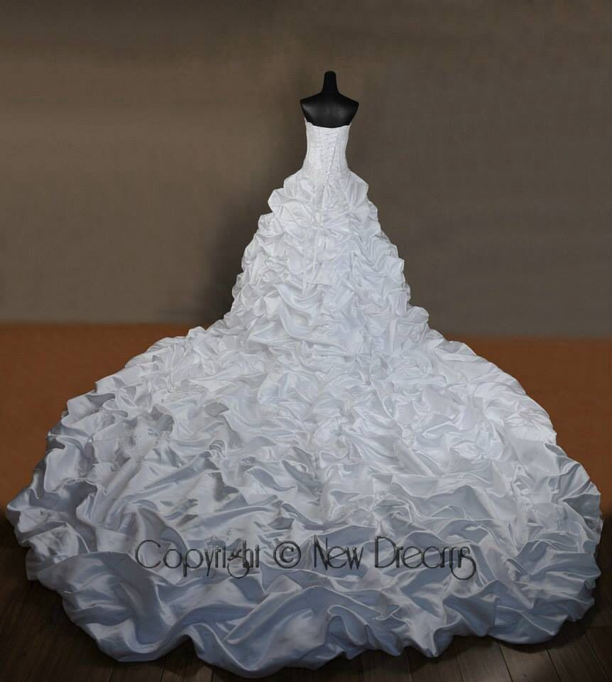 A dreaming wedding dress with really long train wedding