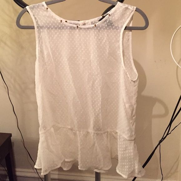 NEW H&M Swiss Dot Peplum Studded Top White Super cute, sheer top from H&M. This is a new, never worn top with studded detailing. The top is a size 8, but I'm a typical small and I like the loose fit of the shirt. Let me know if you have any questions, thanks! H&M Tops Blouses