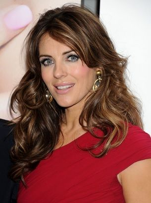 This long curls look is the best fit for Elizabeth Hurley, especially with the light brown highlights running throughout the hair. The curls have been pulled apart just enough to look free flowing and natural, while the highlights give the hairstyle depth and dimension.