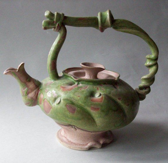 curly green tea pot by lawatson on etsy.com.  i wish i could have afforded this one.