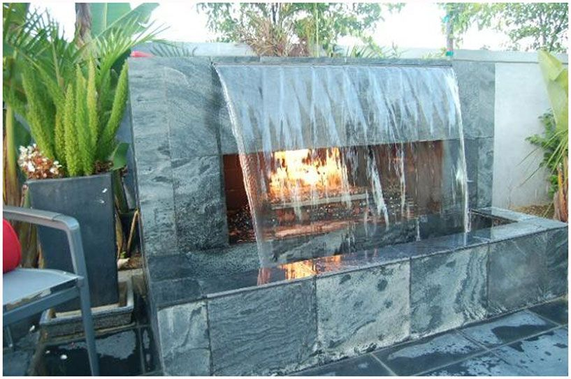 Outdoor Fireplace With Water Feature In