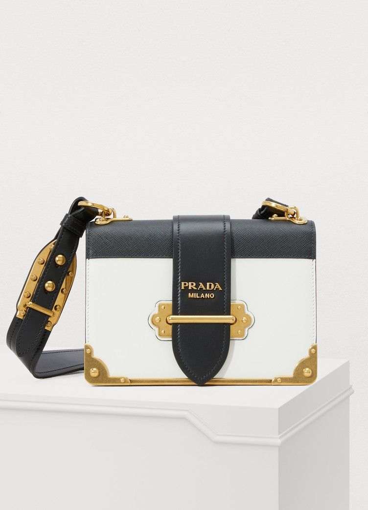 721a915ebd95 The iconic Cahier shoulder bag from Prada is a compact and elegant model.  Signed in