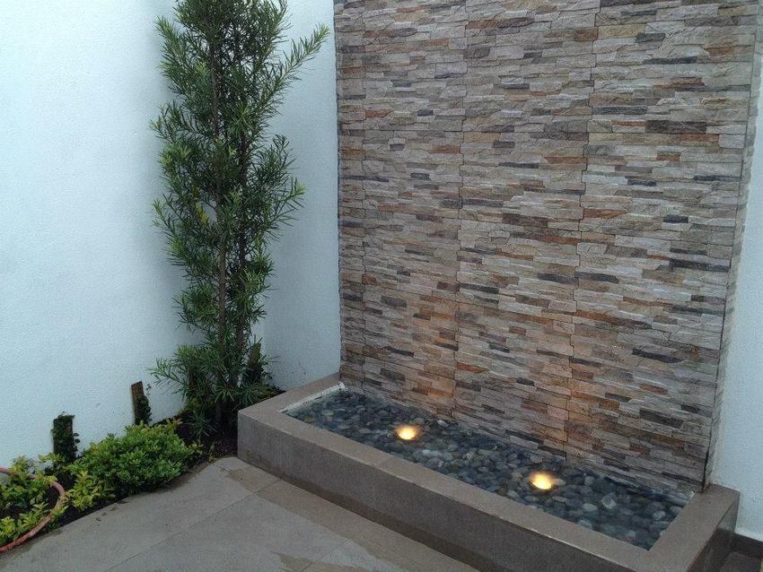 Como hacer un muro lloron paso a paso buscar con google for Cascadas de piedra para jardin