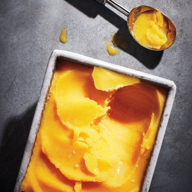 This caliente mango sorbet is just the right amount of refreshing, thanks to honey, chili, and lime juice. Make the healthy desert for a summer evening treat. | Health.com