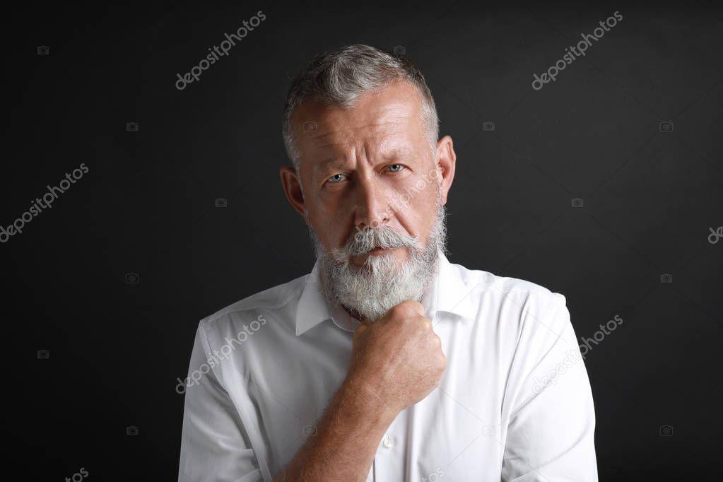 Portrait of handsome senior man on black background  Stock Photo