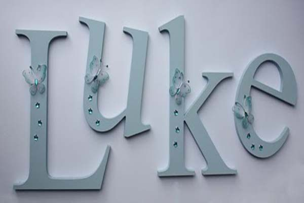 cute ideas for making wooden letters for baby room with green butterfly http