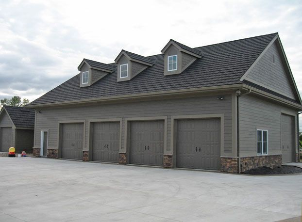 Photo of Wick Buildings Big Toy Sheds, Work Shops & Garages, Homes/Cabins, Re-roof