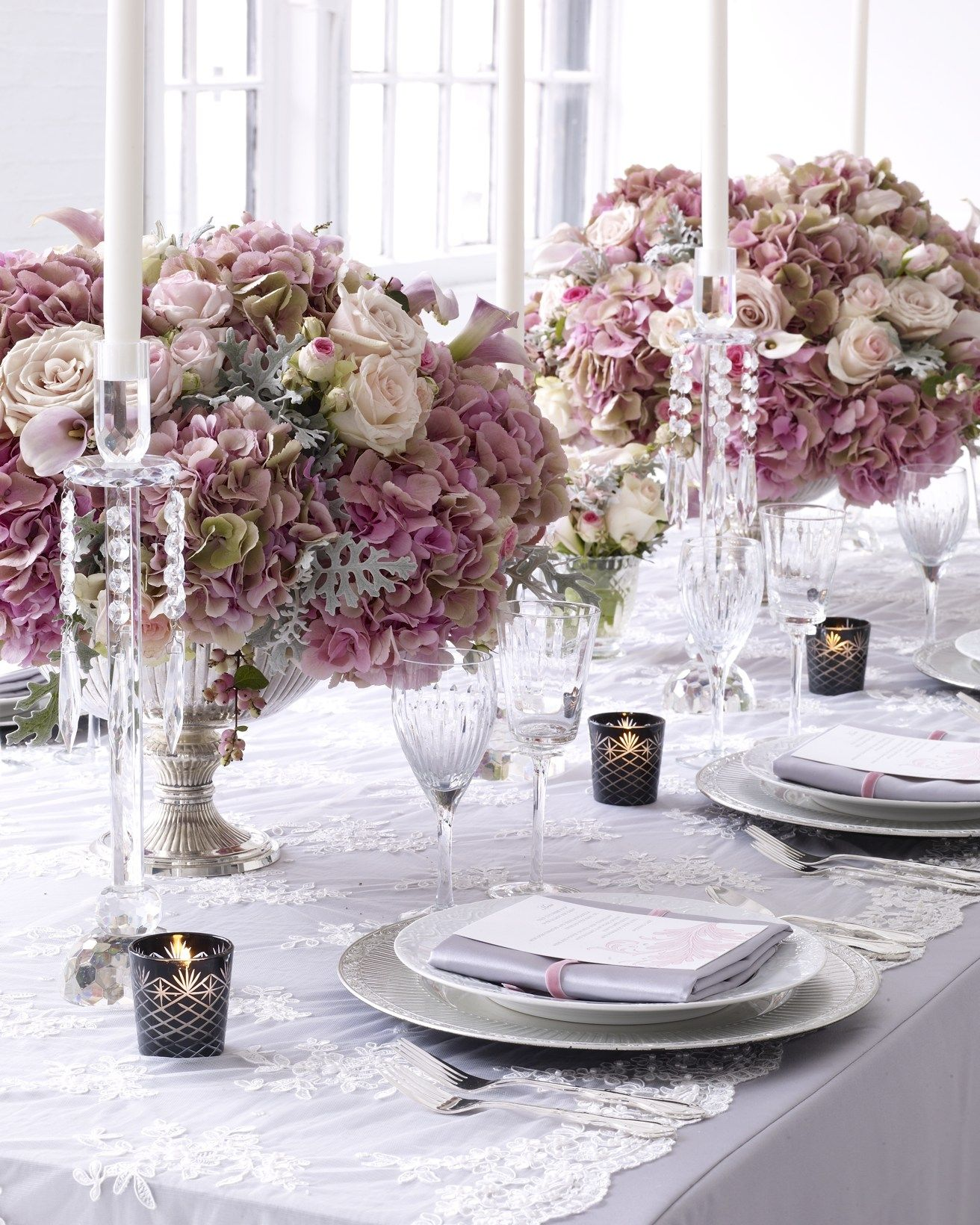 Romantic pink, ivory and antique rose centerpieces in antique silver ...
