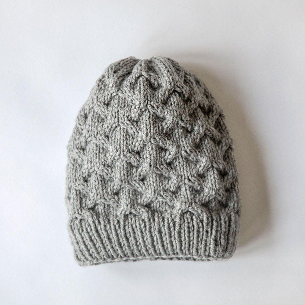 """This pattern is an Instant Download file with instructions for how to knit a soft, stylish cable knit hat. Sizes: Baby, Child, Adult. Materials: - Bulky weight yarn - Size 10 (6 mm) 16"""" circular knitting needles - Size 10 (6 mm) double pointed knitting needles - Cable needle - Stitch Marker - Scissors - Yarn needle Skill level is intermediate. You have my permission to sell any items that you create with my patterns, but they are copyrighted so please do NOT copy, share, adjust, or resell…"""
